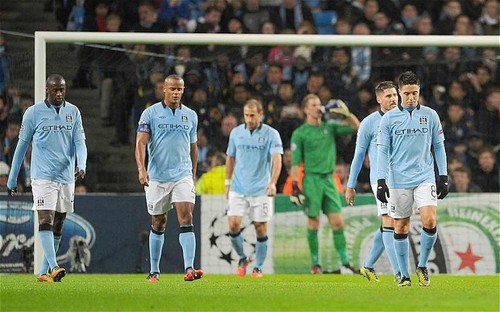 A dejected Manchester City team aim to finish strong